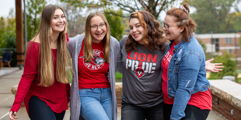 Bryn Athyn College students with arms linked