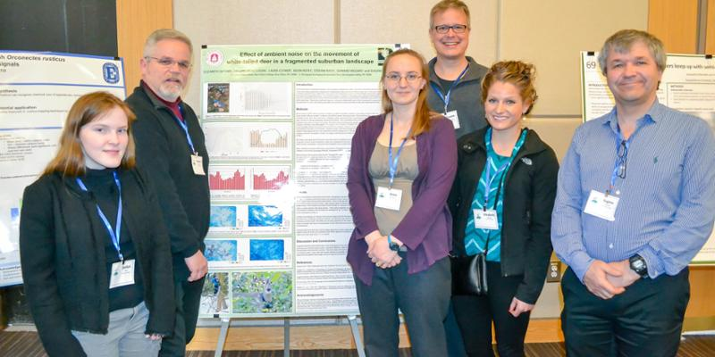 Bryn Athyn College students and professors presenting research poster