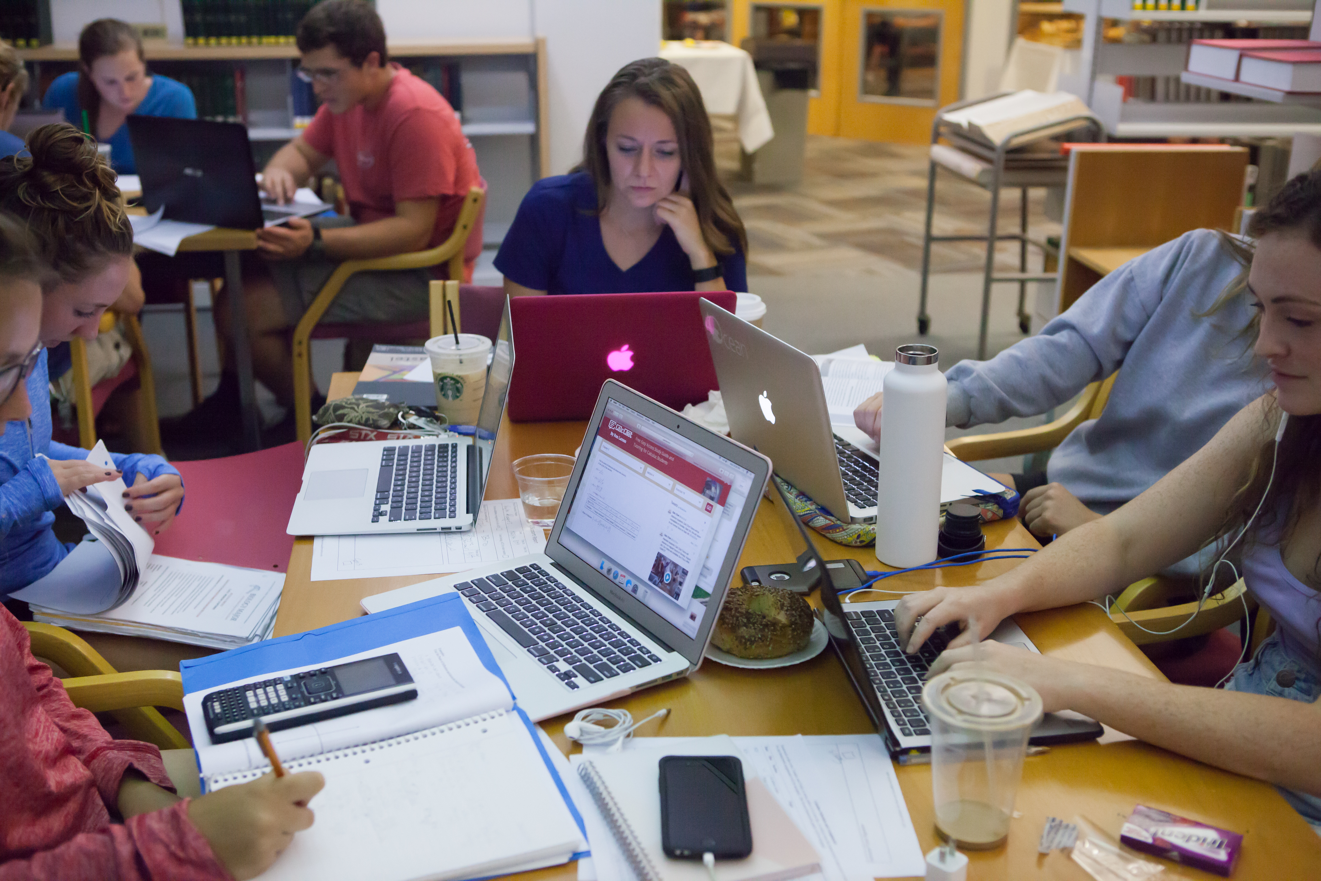 Bryn Athyn College students working on laptops in library
