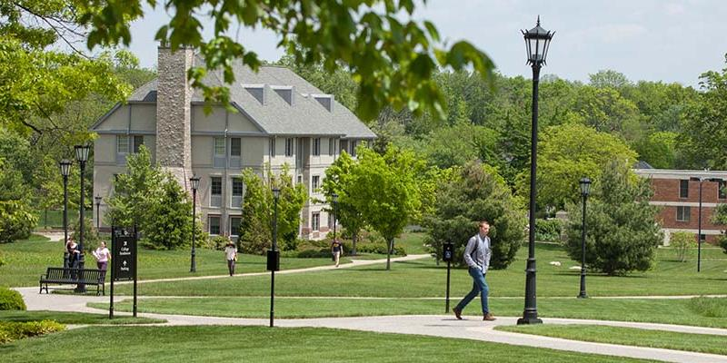 Students walking outside near residence halls at Bryn Athyn College