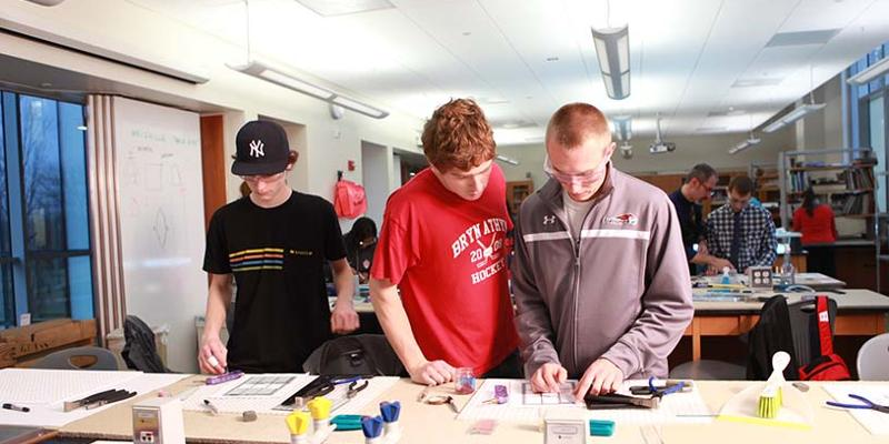 Bryn Athyn College students working on stained glass piece