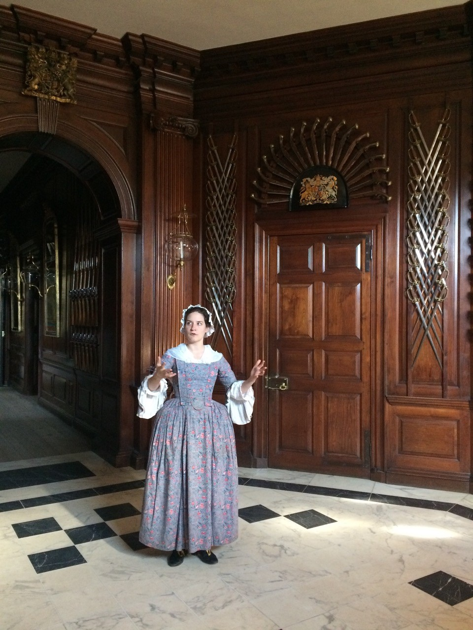 Bryn Athyn College alumna Dara King ('13) guides visitors through the governor's palace