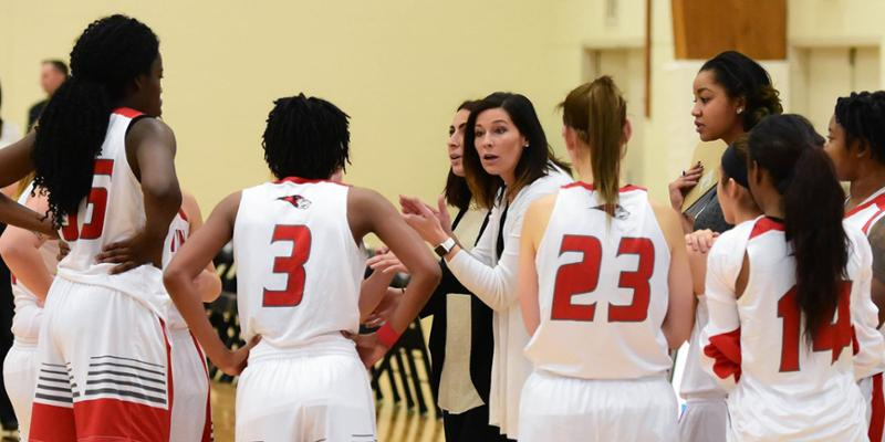 Bryn Athyn College Basketball coach Kayla Felty with her team in a huddle