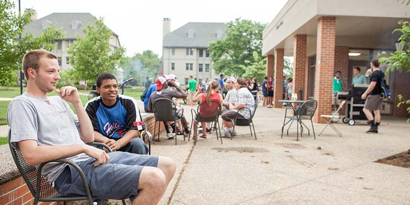 Bryn Athyn College students having a barbecue on campus
