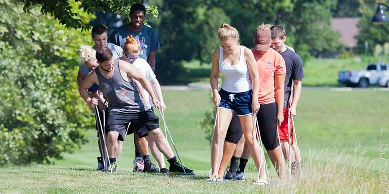 Bryn Athyn College students doing a team building task