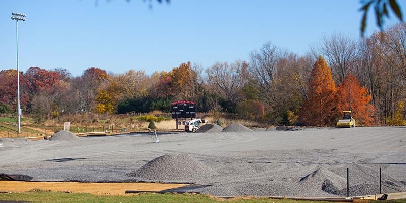 Bryn Athyn College's new turf field under construction with gravel being smoothed